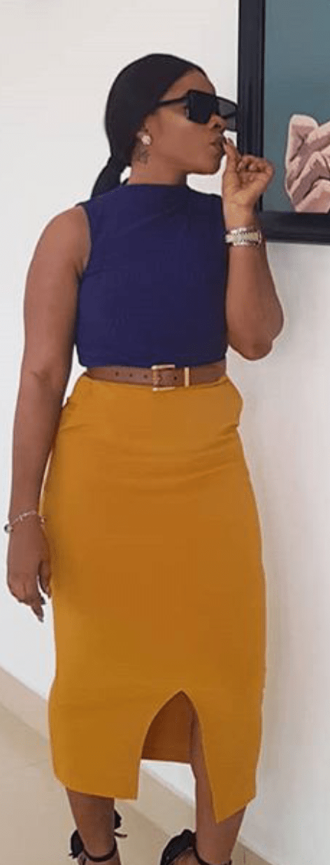 Top Nigerian social Media Influencer Laura Ikeji in a blue and yellow top