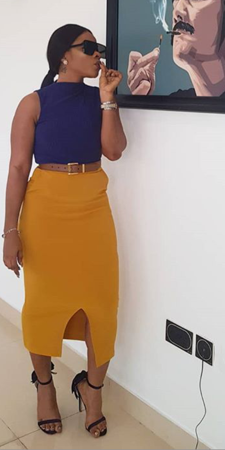 Laura Ikeji looing beautiful in a blue top and skirt on Instagram