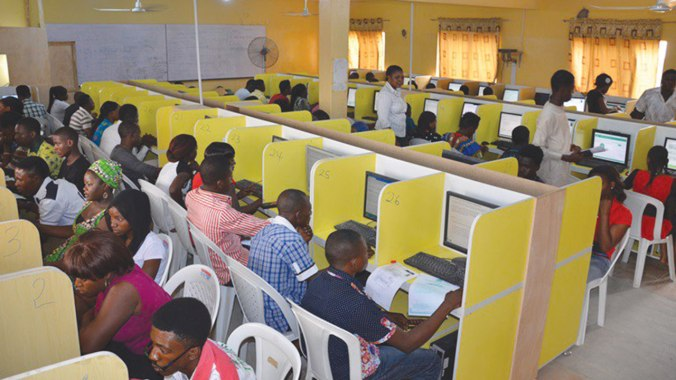 Images of students taking their JAMB exams