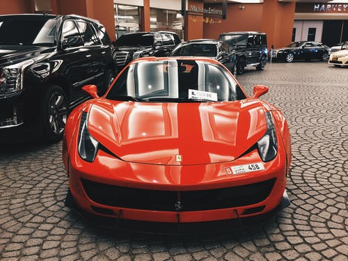 red Ferrari in an automobile Blog niche
