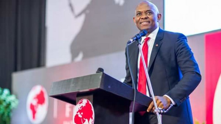 Tony Elumelu speaking to 2019 winners in a red suit