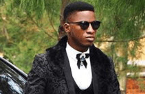 Akin Faminu in black tuxedo suits graduates from Unilag